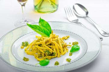Italian pasta with basil pesto, late harvest wine