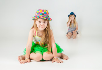 Cute little girls on white background