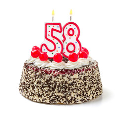 Geburtstagstorte mit brennender Kerze Nummer 58