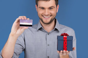 man holding present box with credit debit card.