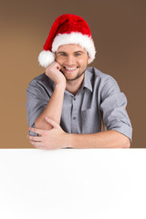 young man looking into camera with blank panel isolated