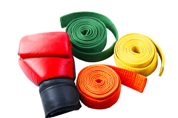 Boxing gloves and collection of belts isolated
