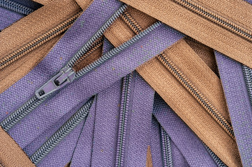purple and brown clothing zippers
