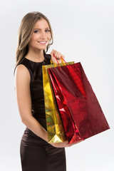 Shopping woman holding bags isolated on white background.