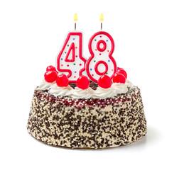 Geburtstagstorte mit brennender Kerze Nummer 48