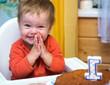 Happy boy celebrates his first birthday