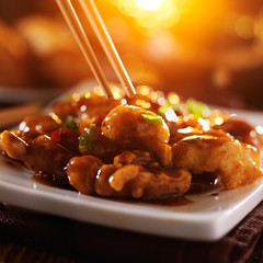 eating general tso's chicken with chopsticks