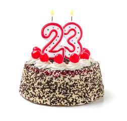 Geburtstagstorte mit brennender Kerze Nummer 23