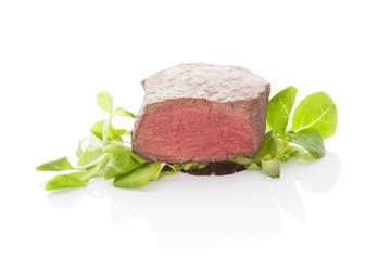 Steak with salad on white background.