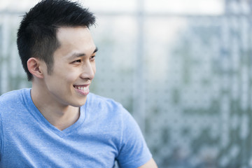 Young asian man smiling