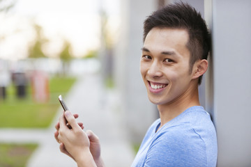 Young asian man with cellphone