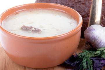 soup kulesh of millet grains and meat with bread, garlic and her