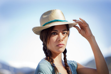 Pretty woman holding a hat