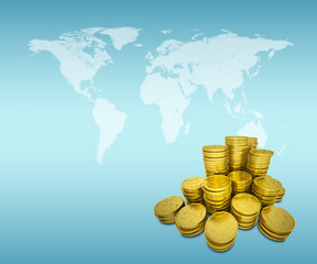Stack of gold dollars and world map