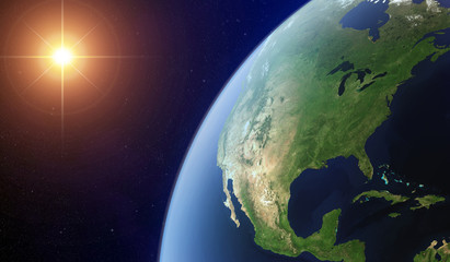View of the North America from space lit by the sun.