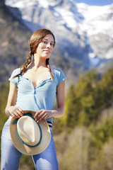 Pretty lady in Tyrol against a beautiful mountain backdrop