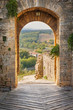 Exit the town of Monteriggioni with views of the Tuscan landscap - 71598886