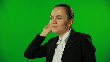 Pretty businesswoman is overhearing on a green screen.FULL HD