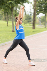Athletic woman training and exercising in the park, healthy life