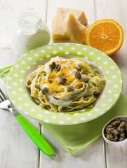 tagliatelle with cream sauce and orange peel