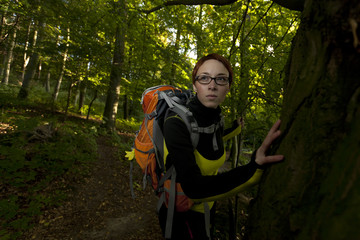 Woman hiking up the forest / explorer