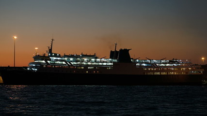 Illuminated cruise ship in late evening