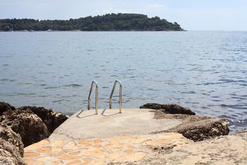 water ladders empty beach