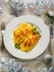 fish fillet with saffron and orange on christmas table