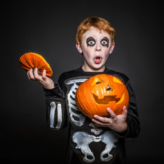 Surprised red haired kid in Halloween costume