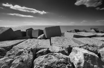 Italy, Sicily, Scoglitti, concrete blocks outside the port