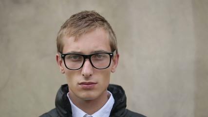 Attractive Man Puts a Glasses