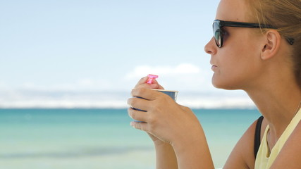 Woman eating ice-cream on the beach