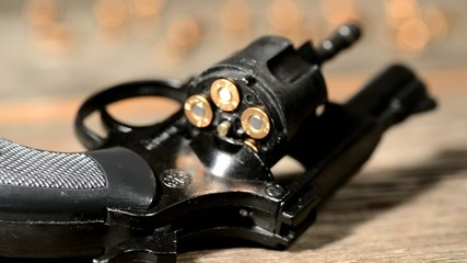 detail of revolver with cartridges ,rack focus