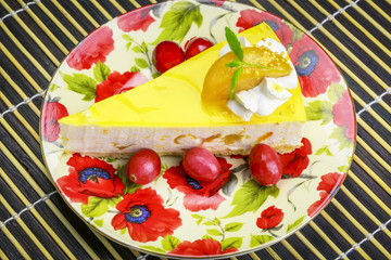 Apple cream cake with cranberries on a plate