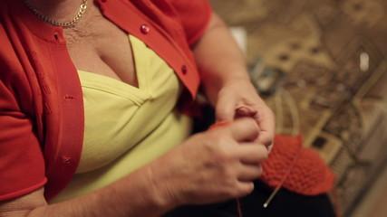 Old Woman Reels Off Yarn