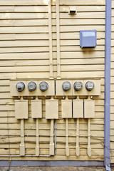 Electric Meters On Side Of Old House