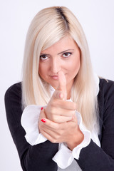 Blond woman hands making a sign with finger like shooting