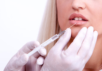 Beauty woman giving botox injections