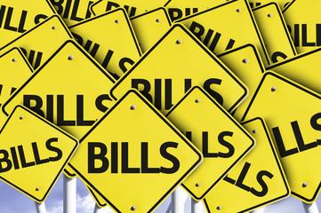 Bills written on multiple road sign