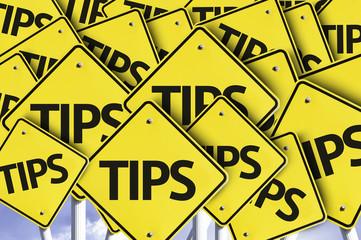 Tips written on multiple road sign