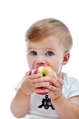 Little boy with big apple