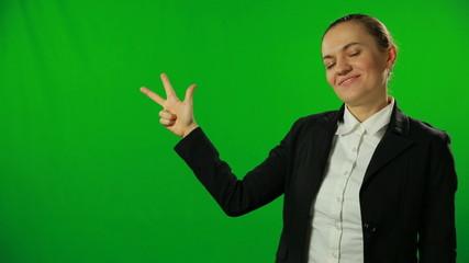 Brunette businesswoman countdown on a green screen.