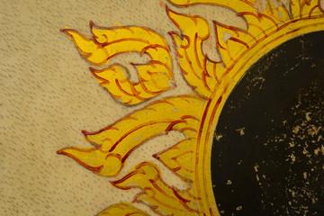 Golden Thai pattern on a ancient Drum surface texture