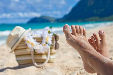 Closeup legs in summer beach