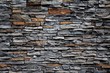 Old brick wall from a stone - 71606467