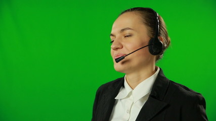 Attractive businesswoman talking, headset. FULL HD, green screen