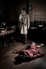 Killer with dead woman lying on the floor