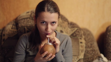 Young Woman Drinking Mate