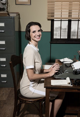 Young vintage secretary at work