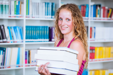 Pretty, young female college student in a library